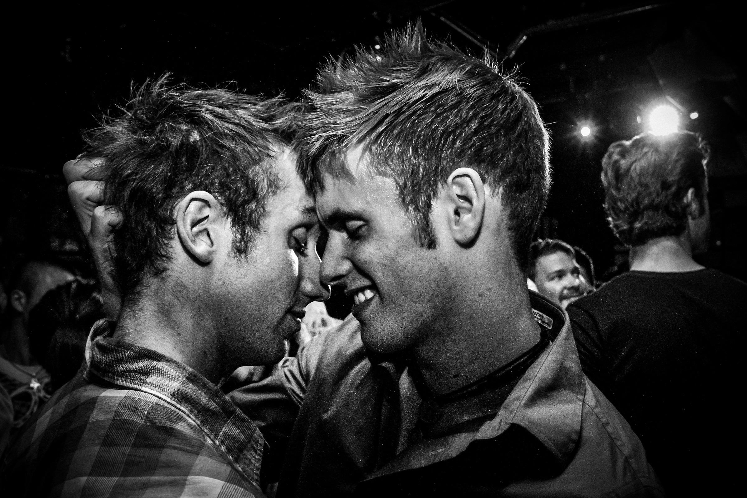 Two men share an intimate moment on the dance floor at a Valentine's party at R Place in Seattle on February 13th, 2011.