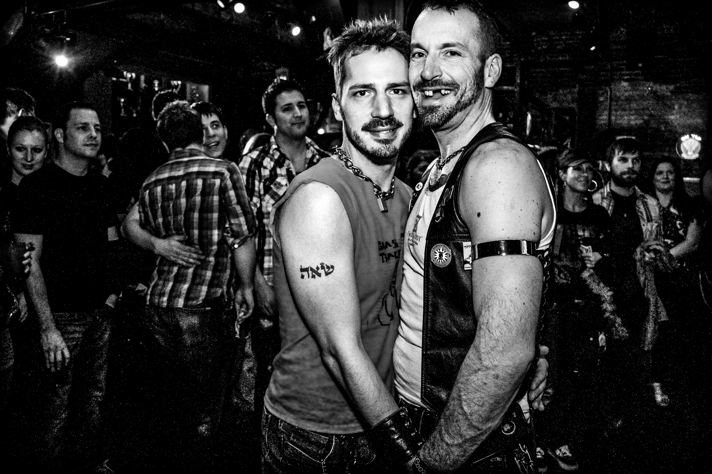 Two men hold hands at R Place on February 18th, 2011, in Seattle.