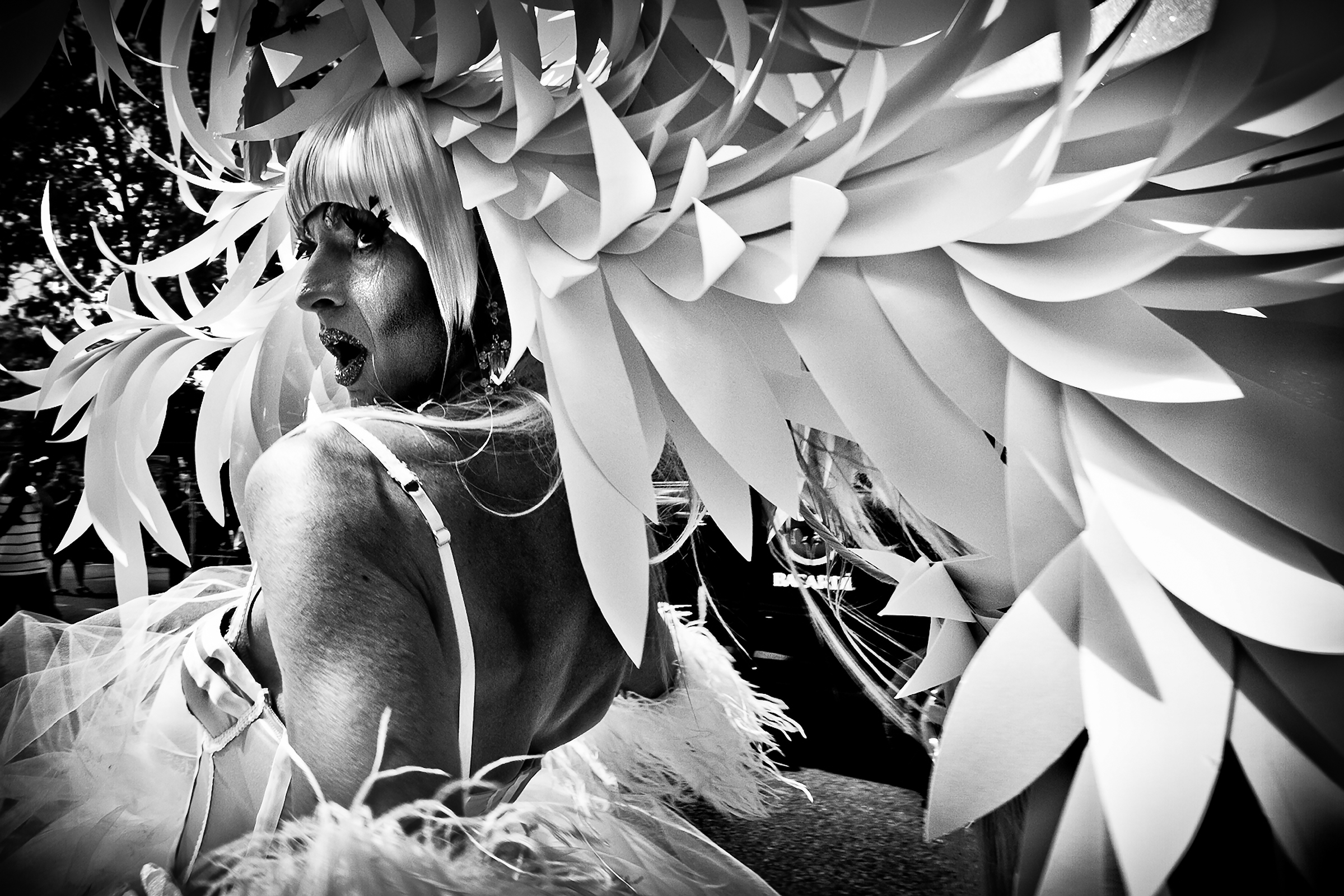 Female impersonator Guy Labrecque, known for his elaborate head pieces, marches in the Vancouver Pride Parade on July 31st, 2011.