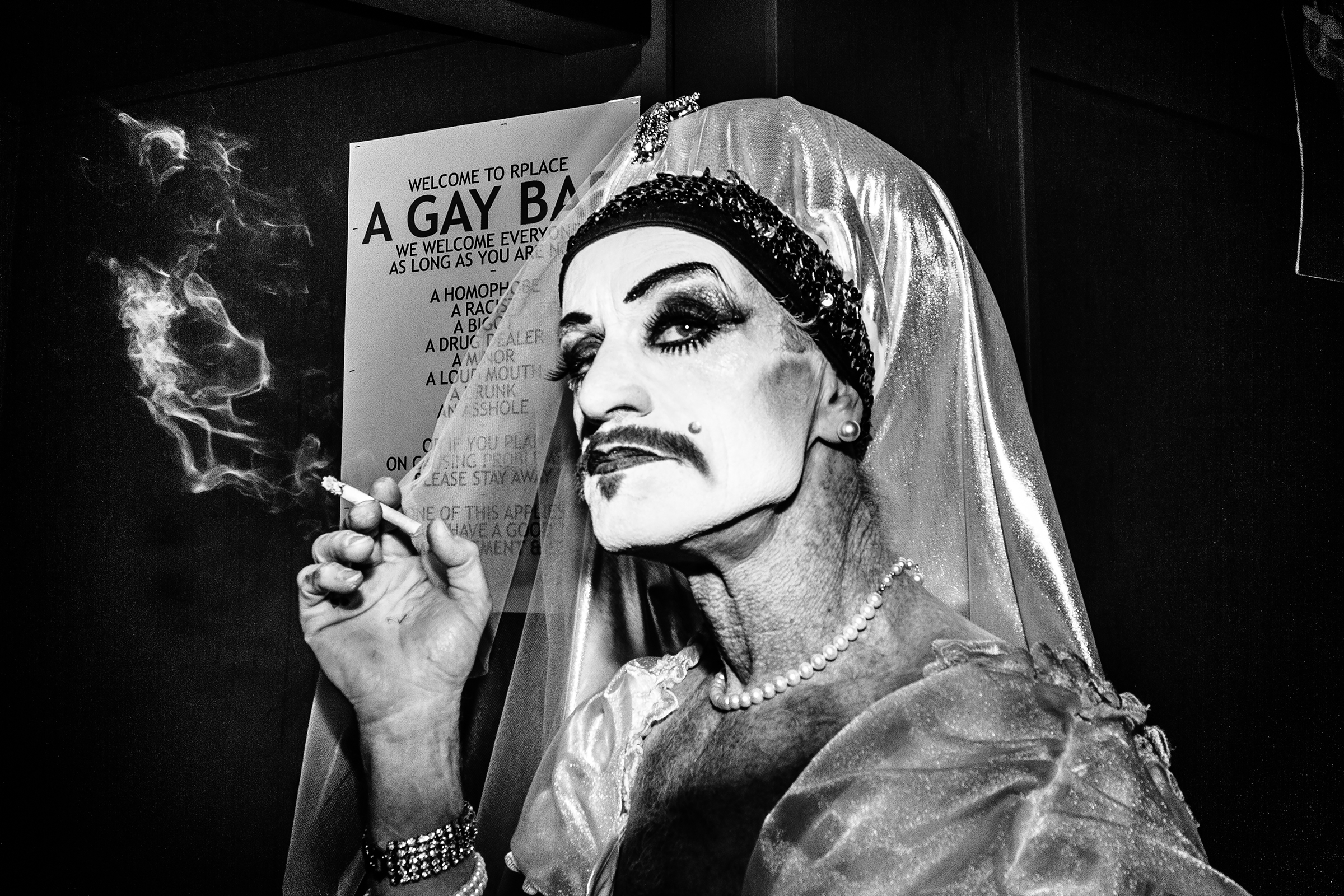 A member of the Sisters of Perpetual Indulgence, The Abbey of St. Joan, drags on a cigarette outside R Place on October 28th, 2011, in Seattle.