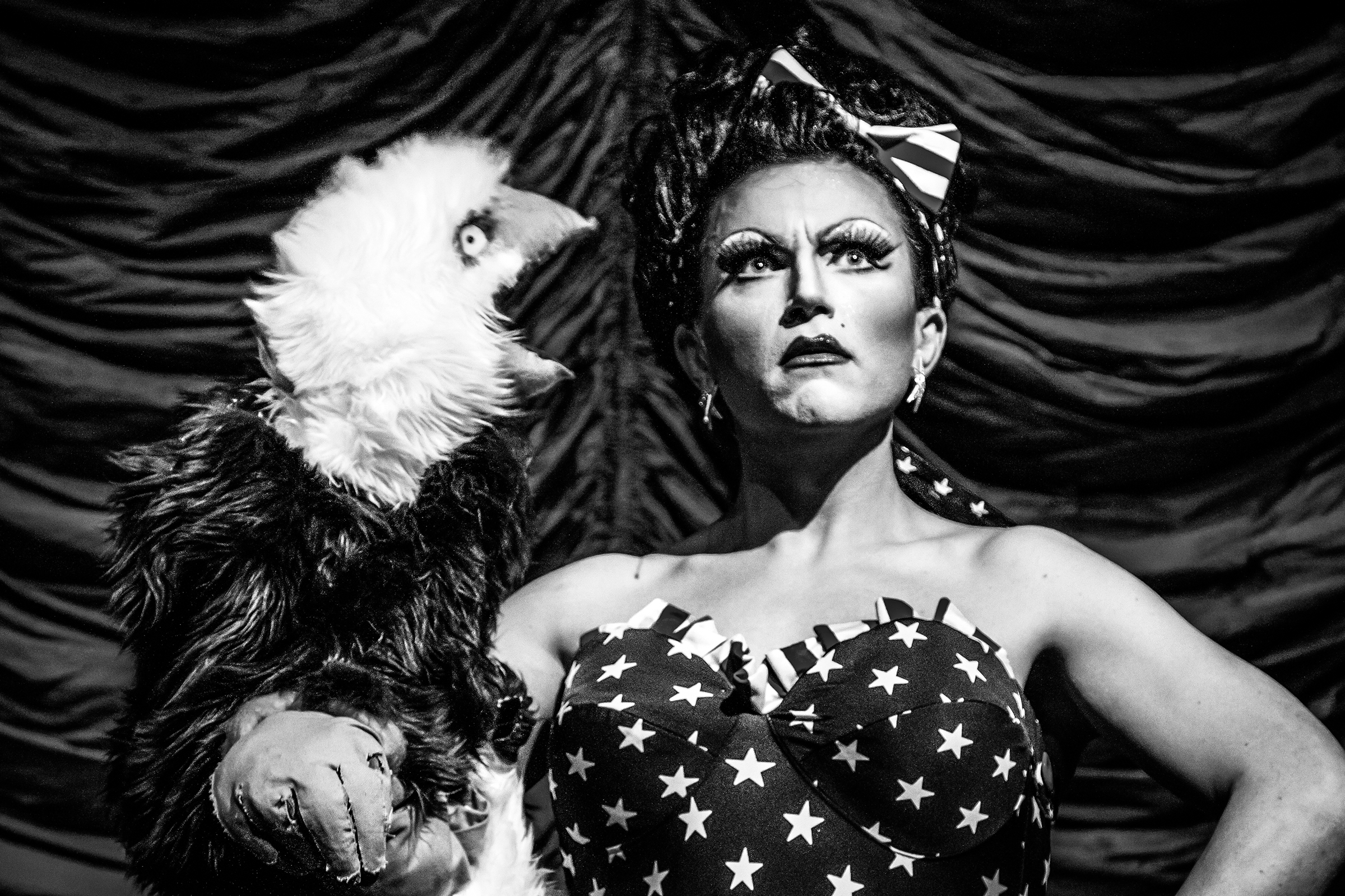 """Ben Delacreme gets lectured by a bald eagle during Freedom Fantasia, """"a liberty-encrusted, justice-soaked, apple-pie-scented pageant of patriotism,"""" at The Triple Door on July 3rd, 2012, in Seattle. The popular drag performer went on to win Miss Congeniality in the sixth season of Logo's Rupaul's Drag Race in 2014."""