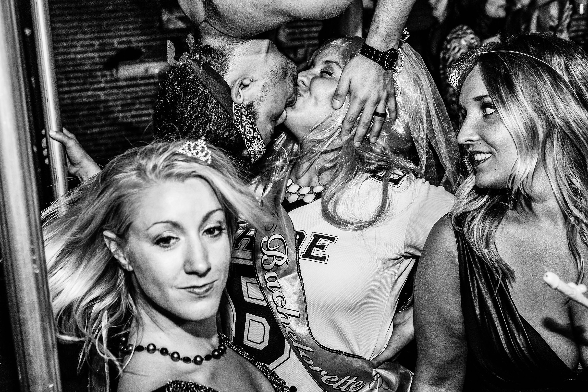 A bachelorette party is entertained by a go-go boy at R Place on June 12th, 2014, in Seattle.