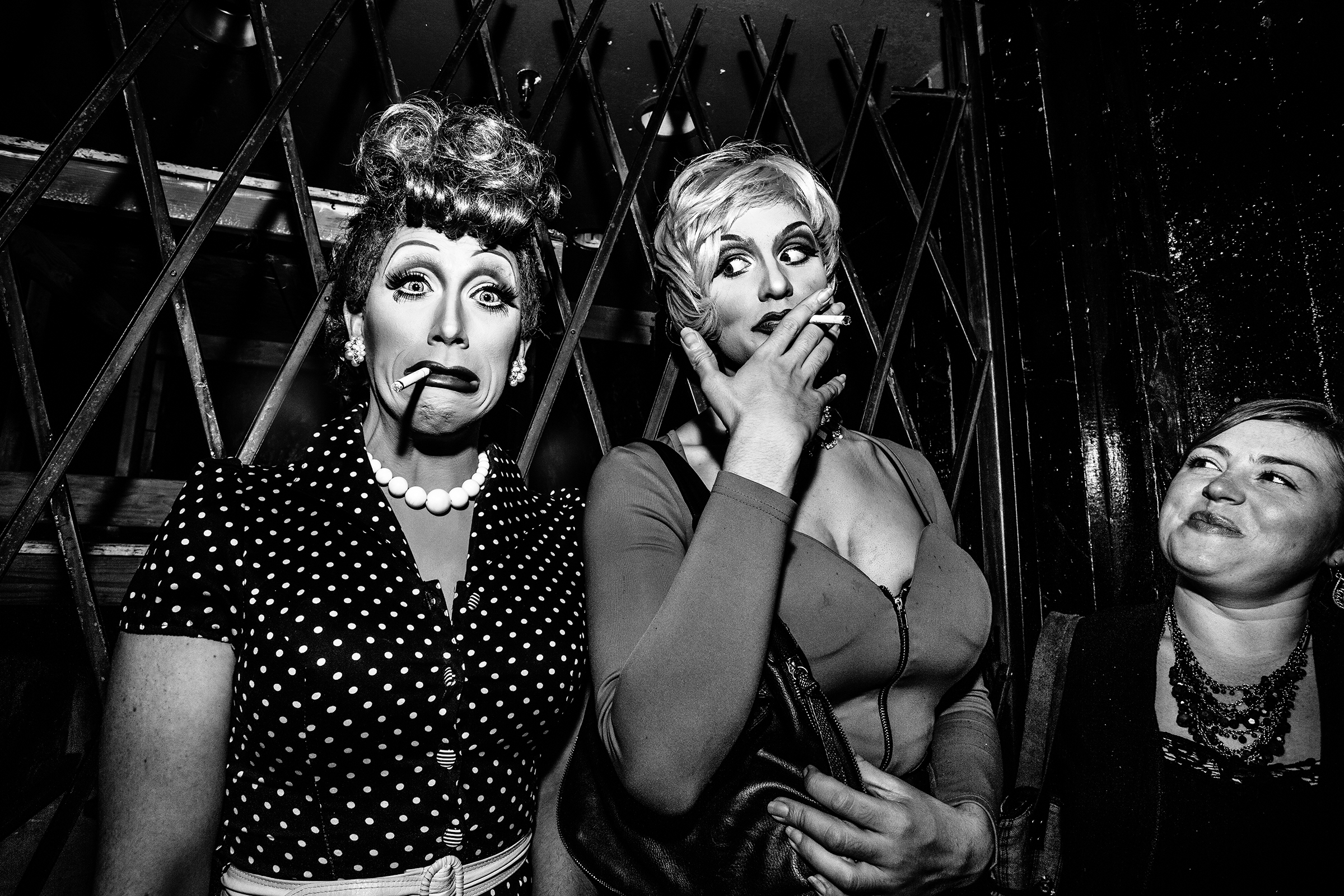 Drag queens drag on cigarettes outside a Pride party at Neighbours Nightclub on June 19th, 2014, in Seattle.