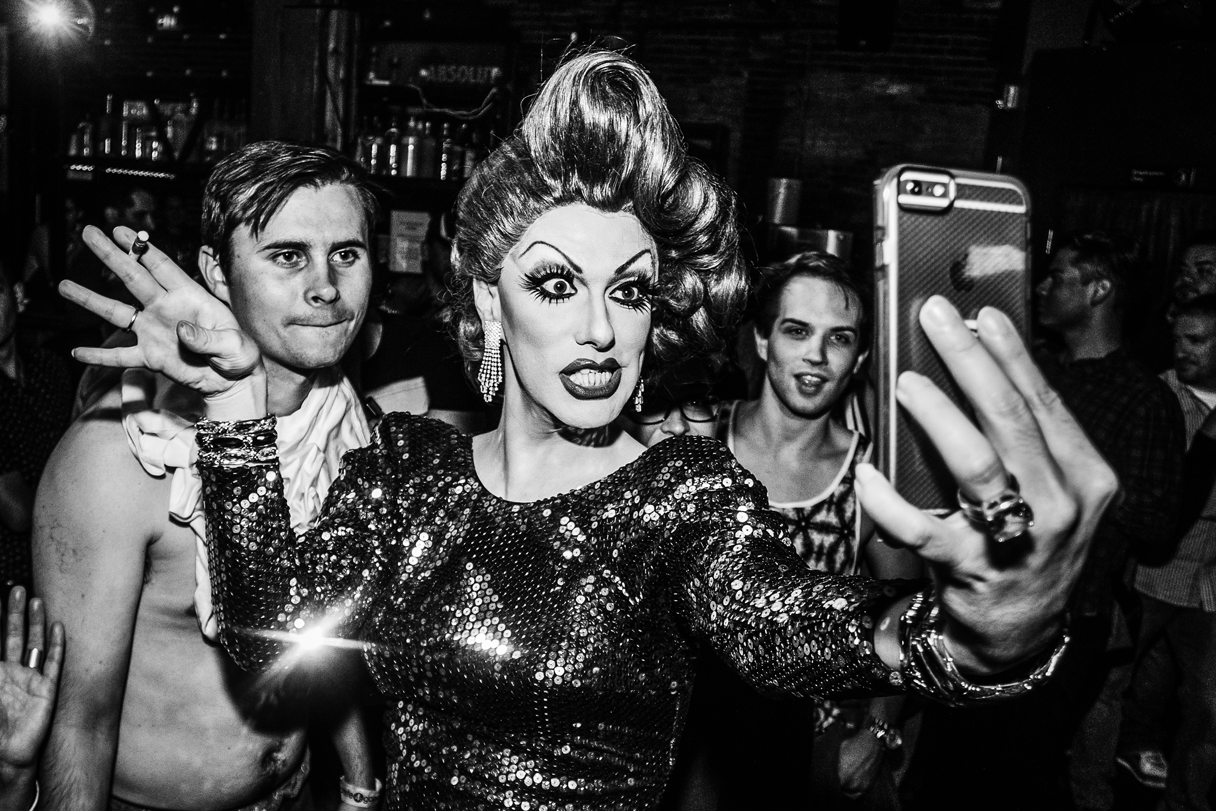 Robbie Turner, who appeared on season 8 of RuPaul's Drag Race, takes a selfie with a patron's phone during a performance at R Place on September 24th, 2015, in Seattle.