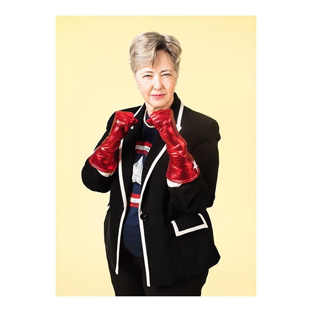 "It was such a pleasure to have Mayor Annise Parker, the first out mayor of a major U.S. city, to my photo studio yesterday to participate in a personal project, of all things. She was so kind with her time and such a sport in front of the camera. When she offered this pose without direction, I asked, ""Are you a boxer?"" She says, ""Yeah."" ""Oh, cool, for how long?"" ""Since Dad taught me."" She's currently the CEO & President of Victory Fund, which for the first time just endorsed a candidate for president: Mayor Pete Buttigieg. Anyway, Mayor Parker's words, everyone: ""I'm the former mayor of Houston. I've been a lesbian activist for more than 40 years. I was blessed to have a mother and a grandmother who were both college graduates, and the expectation was that I would educate and support myself and that education was a power no one could take away from me. My wife and I were married almost 6 years ago on our 23rd anniversary, so that's nearly 23 years of living in sin and 6 years of having a relationship honored by the state. We have 4 children. Our eldest was 16 when he came to live with us — on the streets because he was gay. That is a sin and a crime, and it gave me a passion for working with homelessness. I am old enough to have experienced what life was like before Stonewall, and was 13 when it happened. It was a very different time and place; I was a vulnerable and frightened kid. It was scary and frustrating, but sooner than later I realized we have no other choice but to get involved to try to make change. Everybody needs a hero, and what I understand today is that we can each be our own superhero. Every one of us has a gift, even if it's just the gift of kindness. We can keep our gift inside or we can share it with the world. It doesn't have to be something that is the bright shiny thing that everybody pays attention to. Mine is being very quietly persistent. I don't have to be out front, but I don't want to be the last one in the door. I don't have to knock the door down, but I will keep knocking. Doesn't open? I'll find another one."""