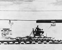 Stapp flies through the desert on one of the Sonic Wind Rocket Sleds.