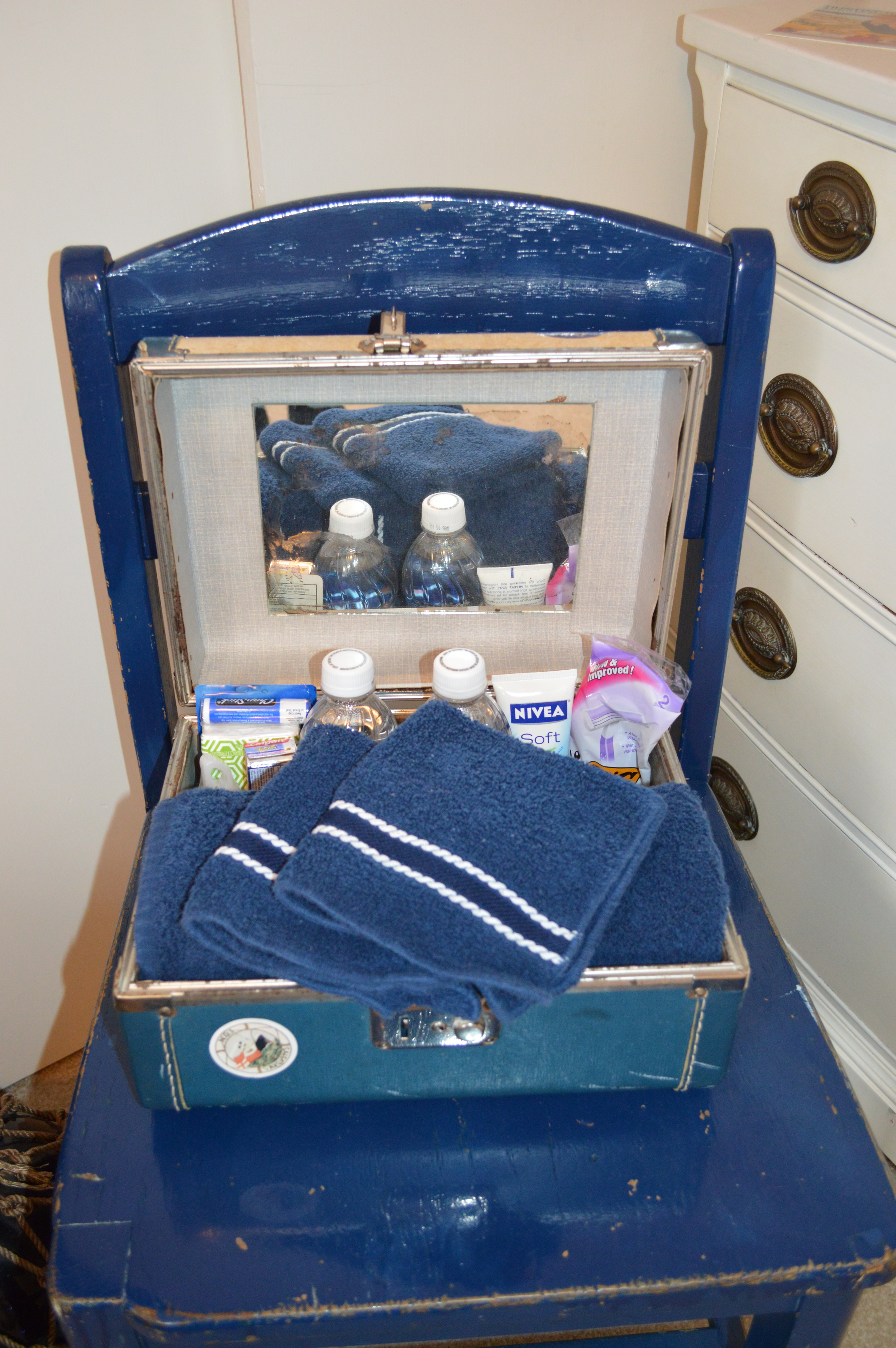 Guest amenities in old cosmetic case in nautical guest room...