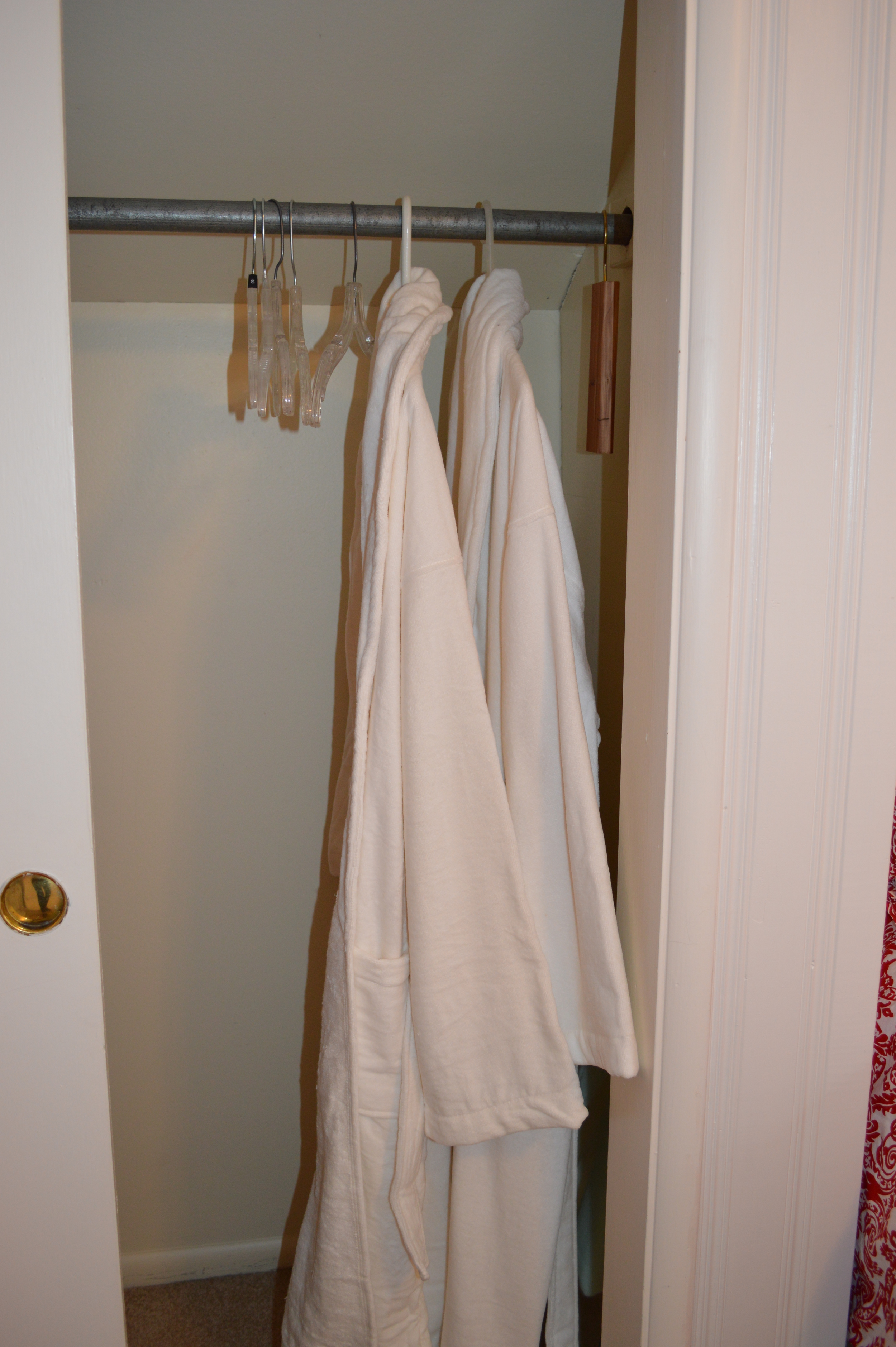 His and Hers bathrobes from IKEA and extra hangers...