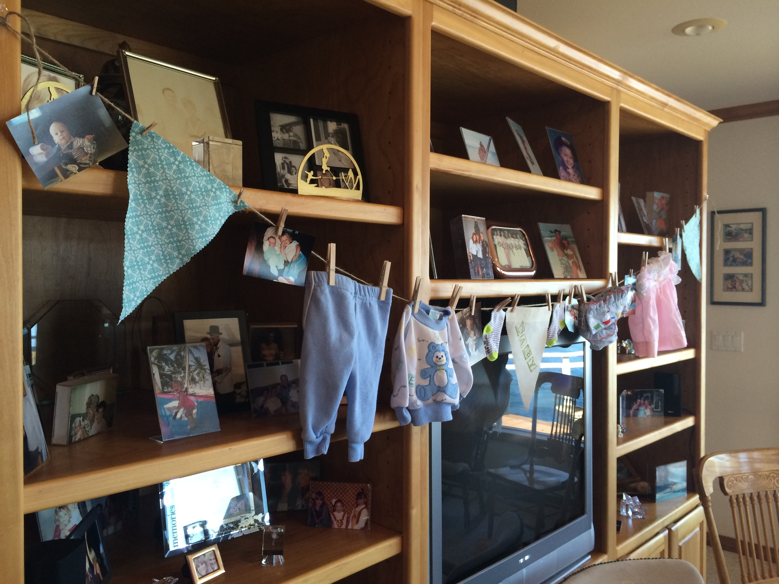 Bunting with actual baby clothes of the father and mother-to-be...