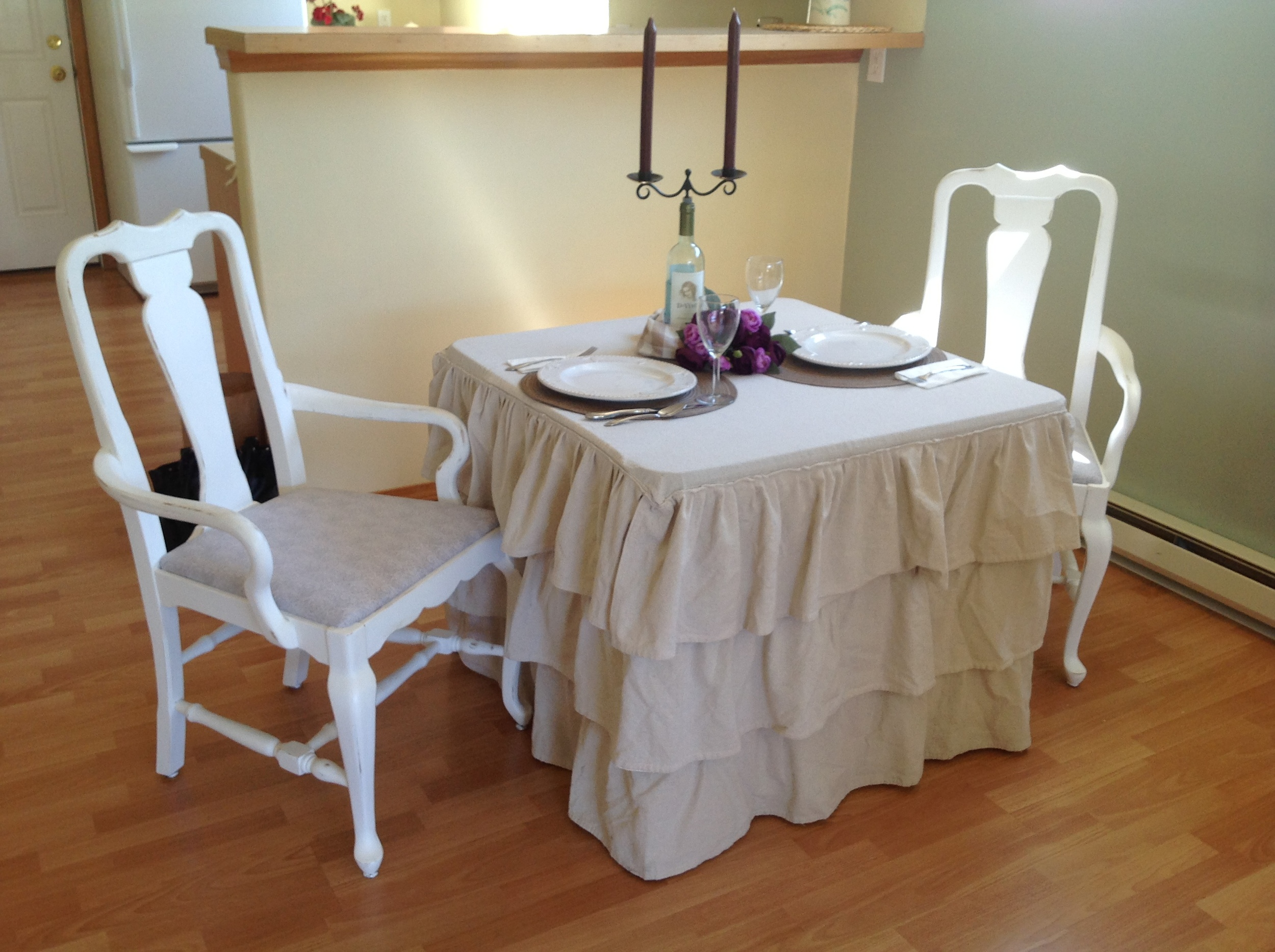 Drop cloth ruffled table cloth over card table...fine dining!