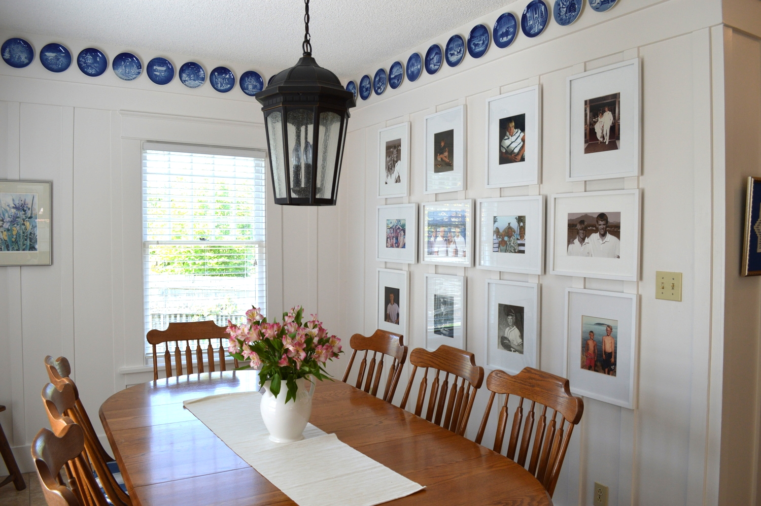 The light fixture came from Seattle Lighting and the frames for the photo wall are from Target...