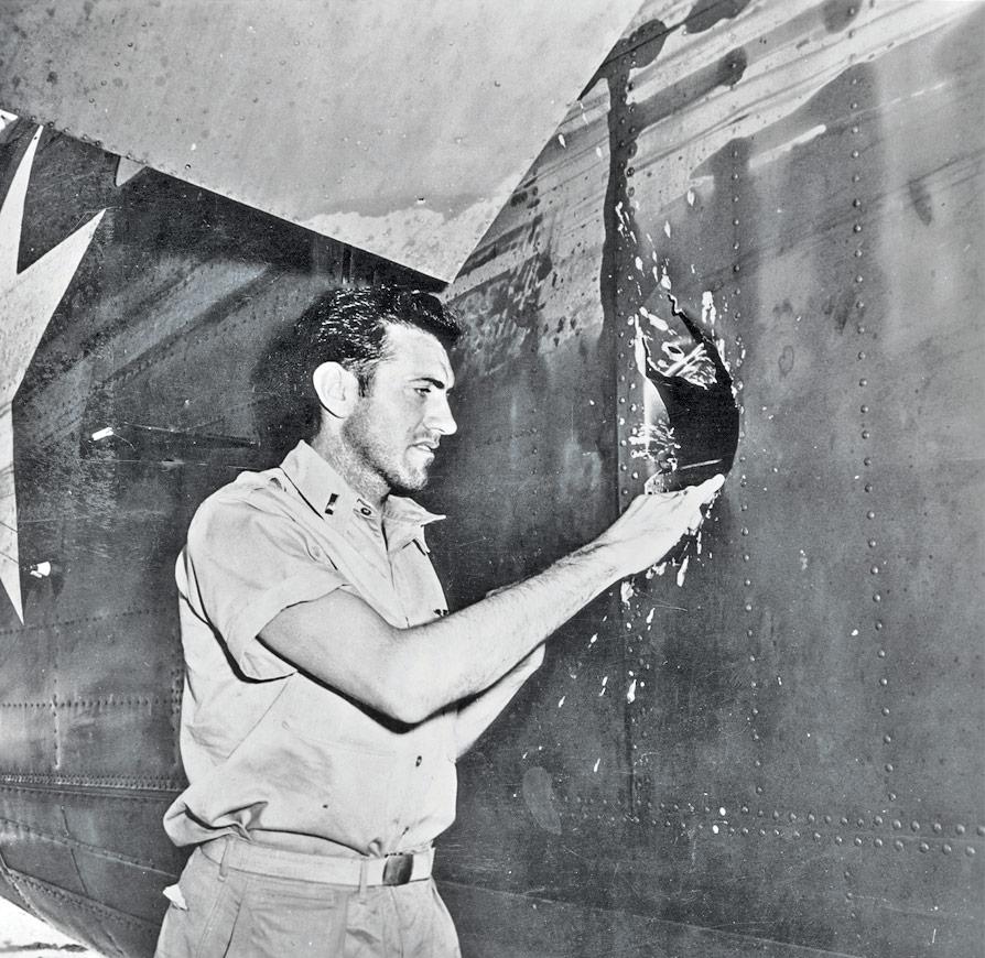 Louie, examining the damage to his plane...via google