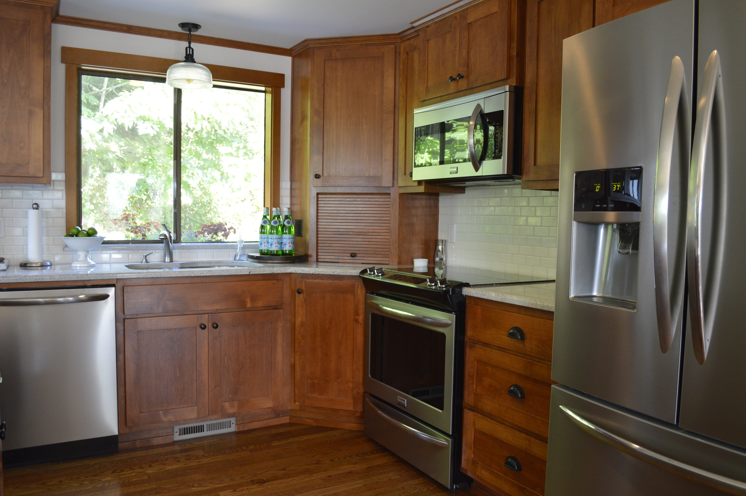 Smudge proof stainless appliances with a corner small appliance garage, new light fixture...