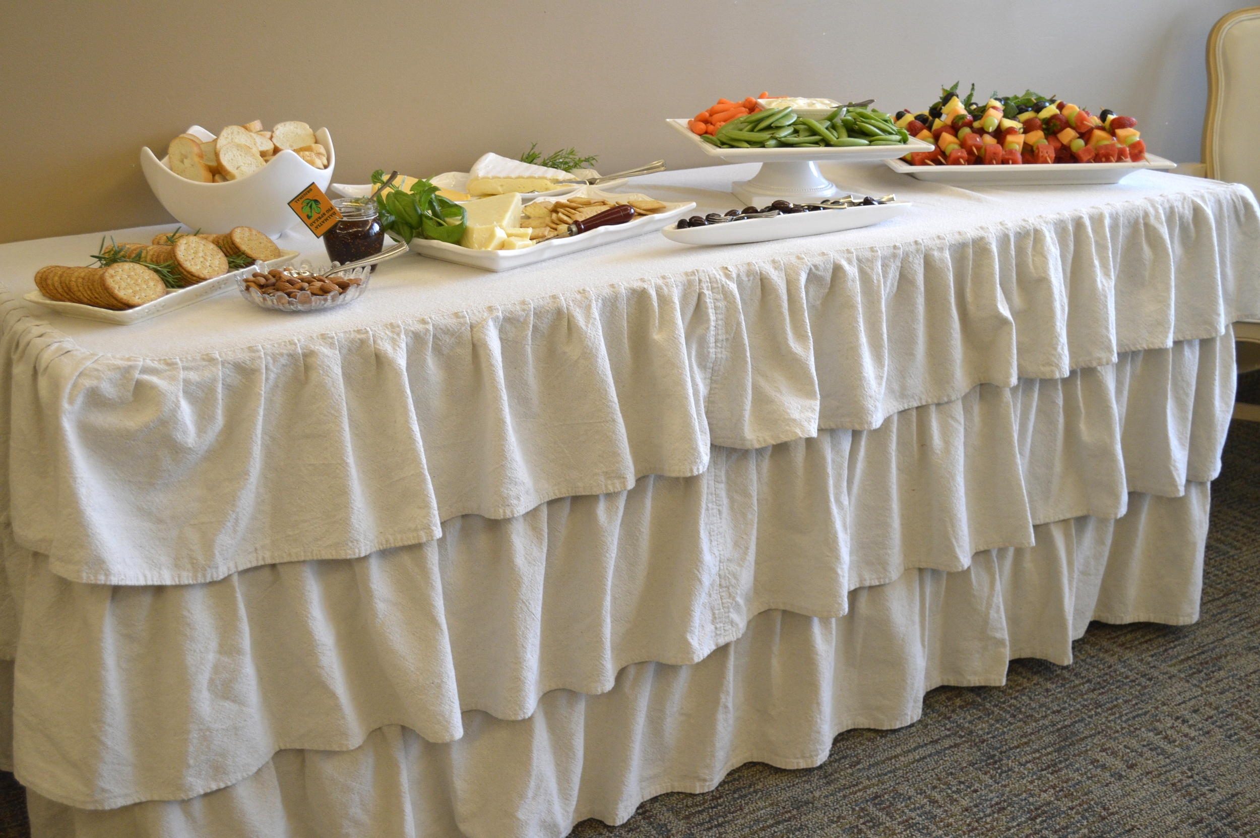 Assorted cheeses and crackers, nuts, olives, fresh veggies, and fruit kabobs...