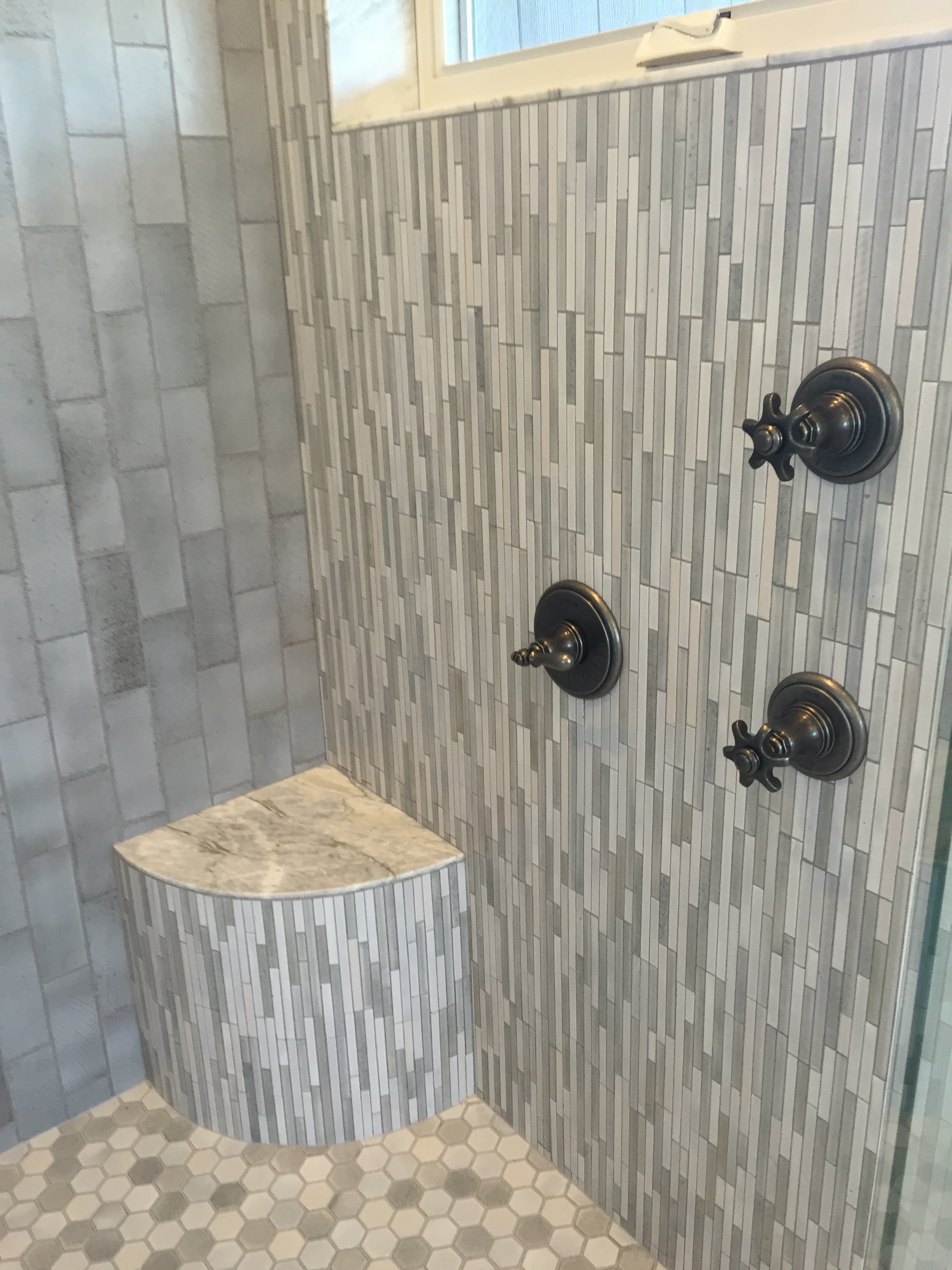 Master shower...look at all the tile patterns!