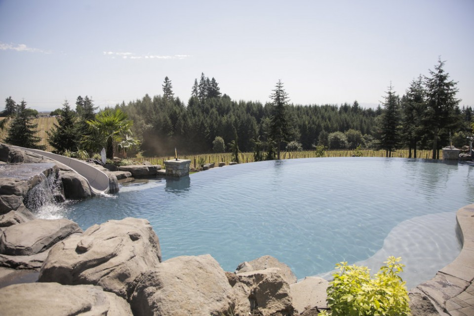 The amazing infinity pool with a concrete slide to the left...(Photo source Oregon Live)