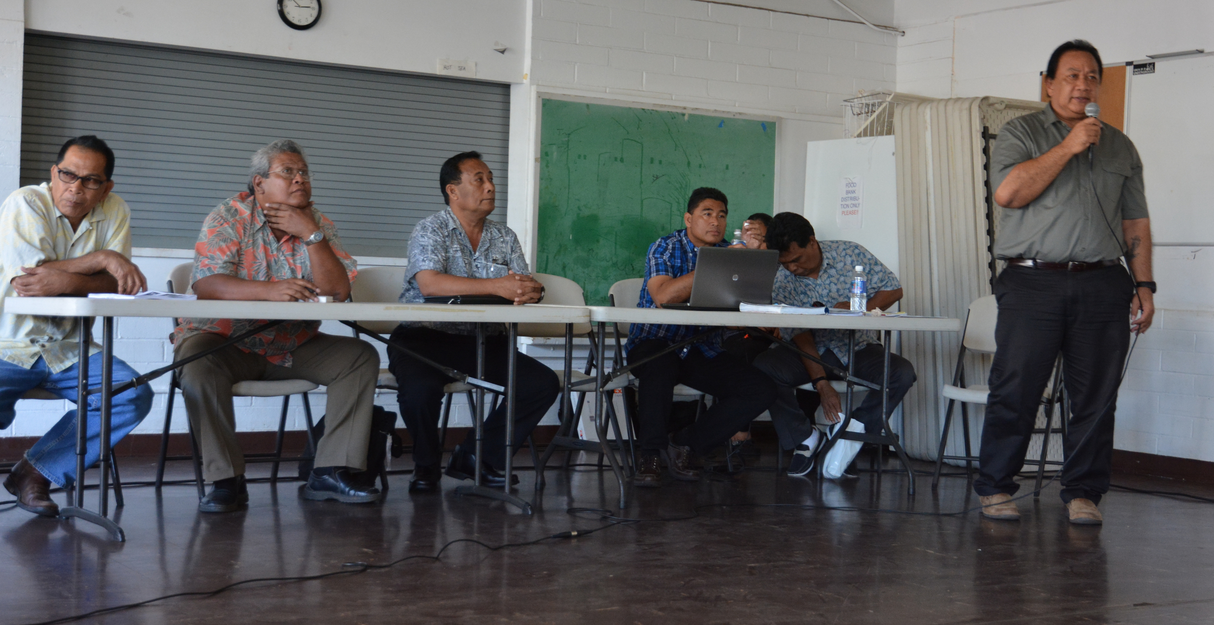 Mark Mailo gives his opening remarks at the Honolulu hearing. (L-R; Jacob Esah, Winiplat Bisalen, Carsom Enlet, Johnny Meippen, Julio Marar, Mark Mailo. Not pictured: Sabino Asor.)