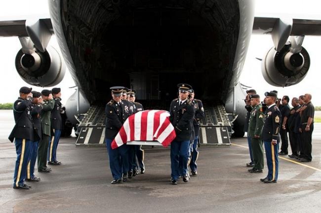 The body of Sgt. Sapuro Brightly Nena, arriving in Kosrae.