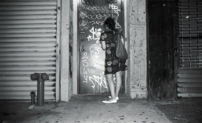 Checking a text in a doorway on the Bowery.    New York, NY 2008