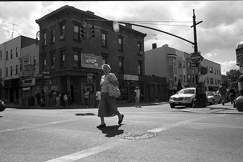 A Polish woman crossing the street.    Greenpoint, Brooklyn 2008