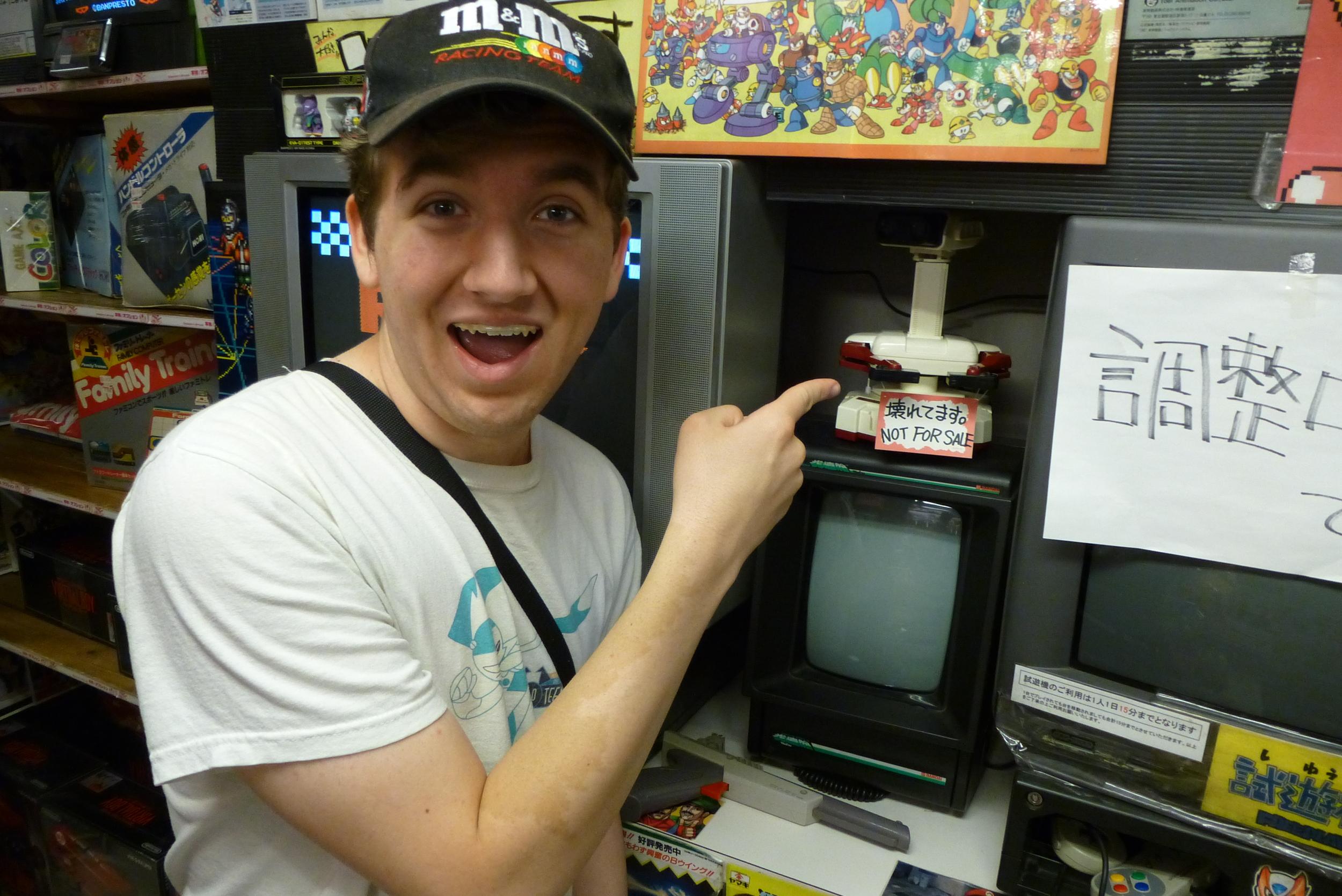 Jack spots a ROB (Robot Operating Buddy) at Super Potato.