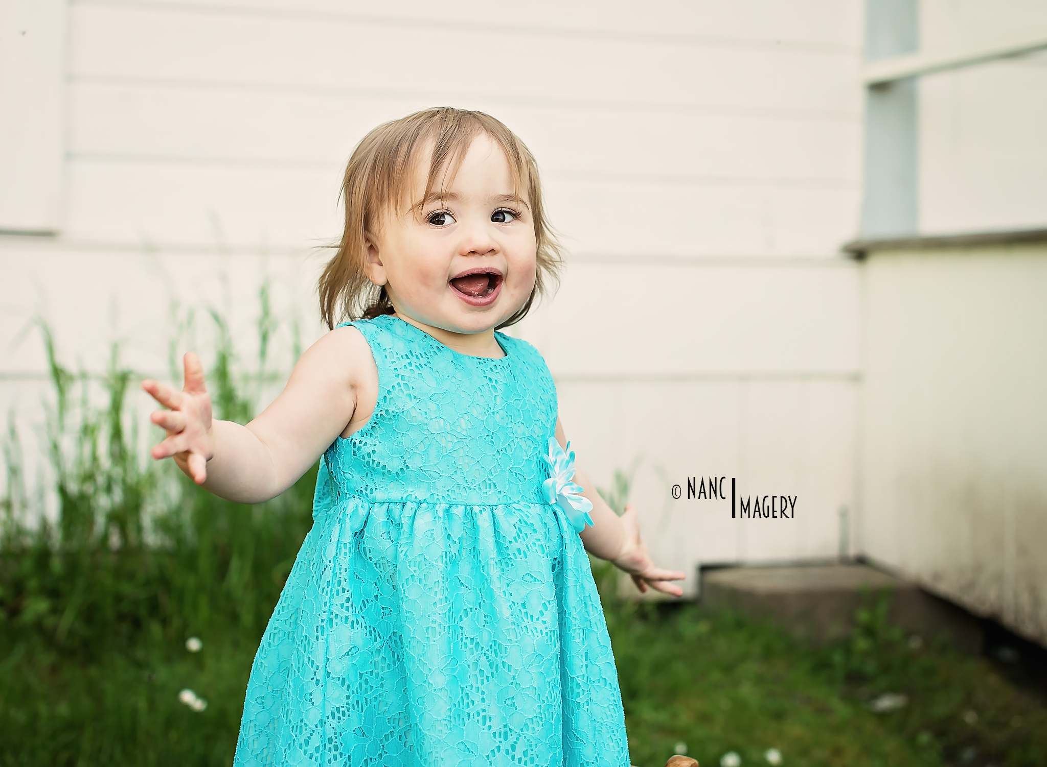 Miss A loves playing Pee-A-Boo! Playing Peek-A Boo totally brought out her personality! She also loves the camera.