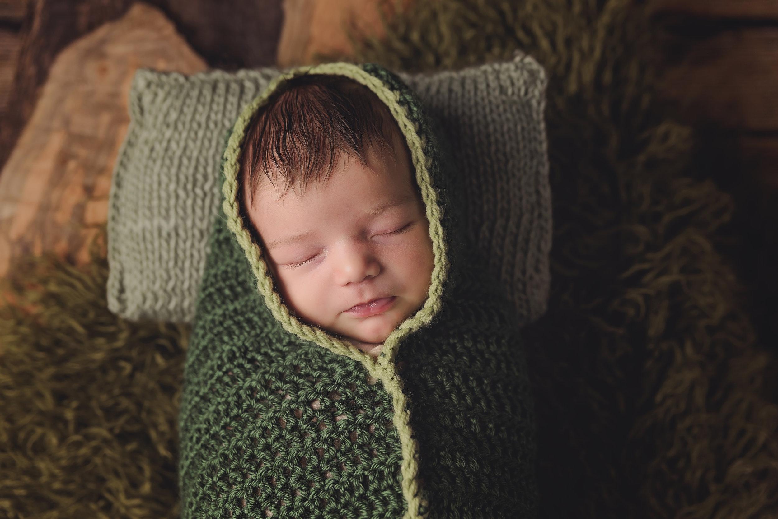 Newborn in a peapod