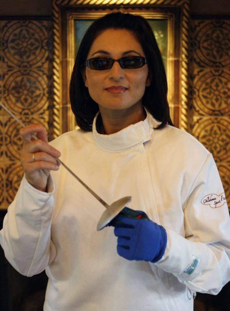 Blind fencer, Cathrine Bolton, who struggles with loss of eyesight and yet practices the Olympic sport
