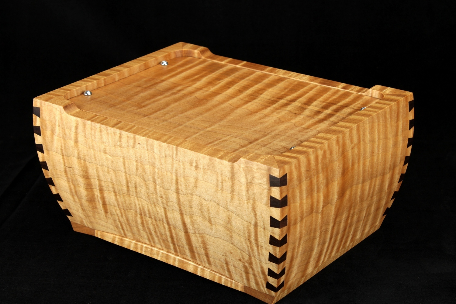 Bottom access panel of a tiger maple sealed urn