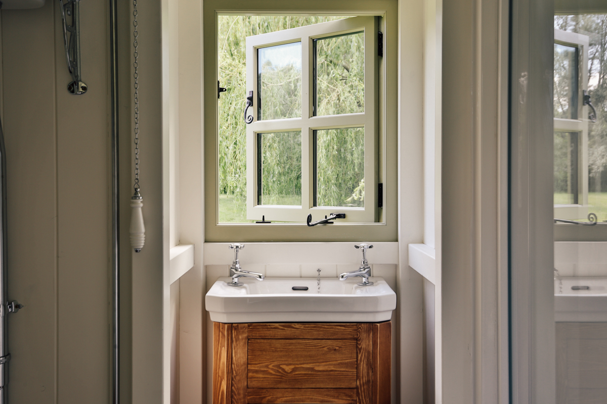 Interior photography of shepherds hut guest room bathroom
