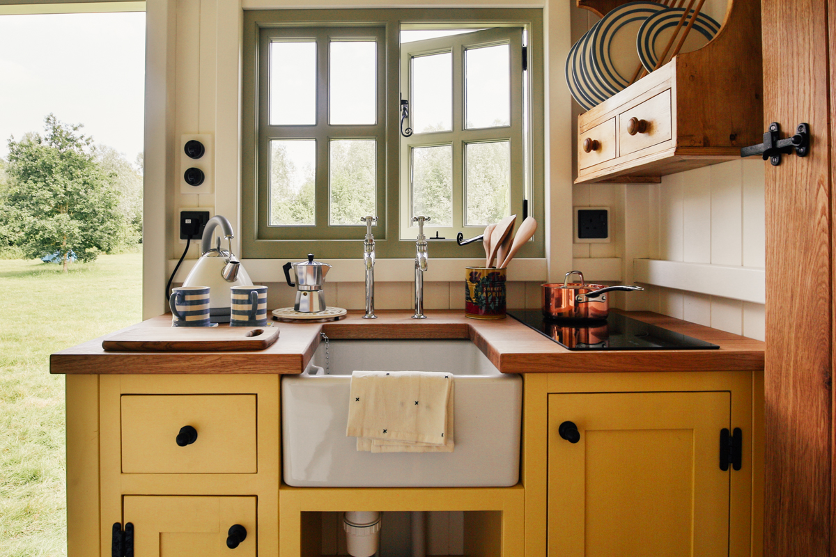 Interior photography of shepherds hut guest room kitchen with butlers sink