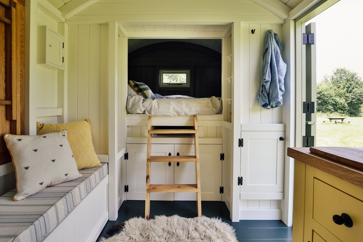 Interior photography of shepherds hut guest room cabin bed area