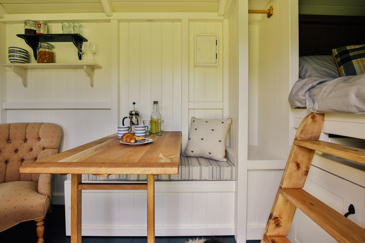Interior photography of shepherds hut guest room dining area