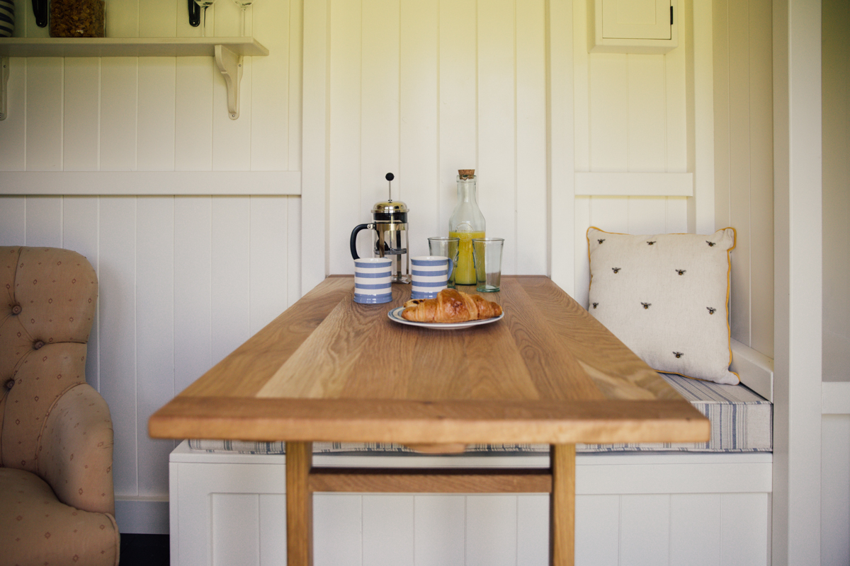 Interior photography of shepherds hut guest room dining table
