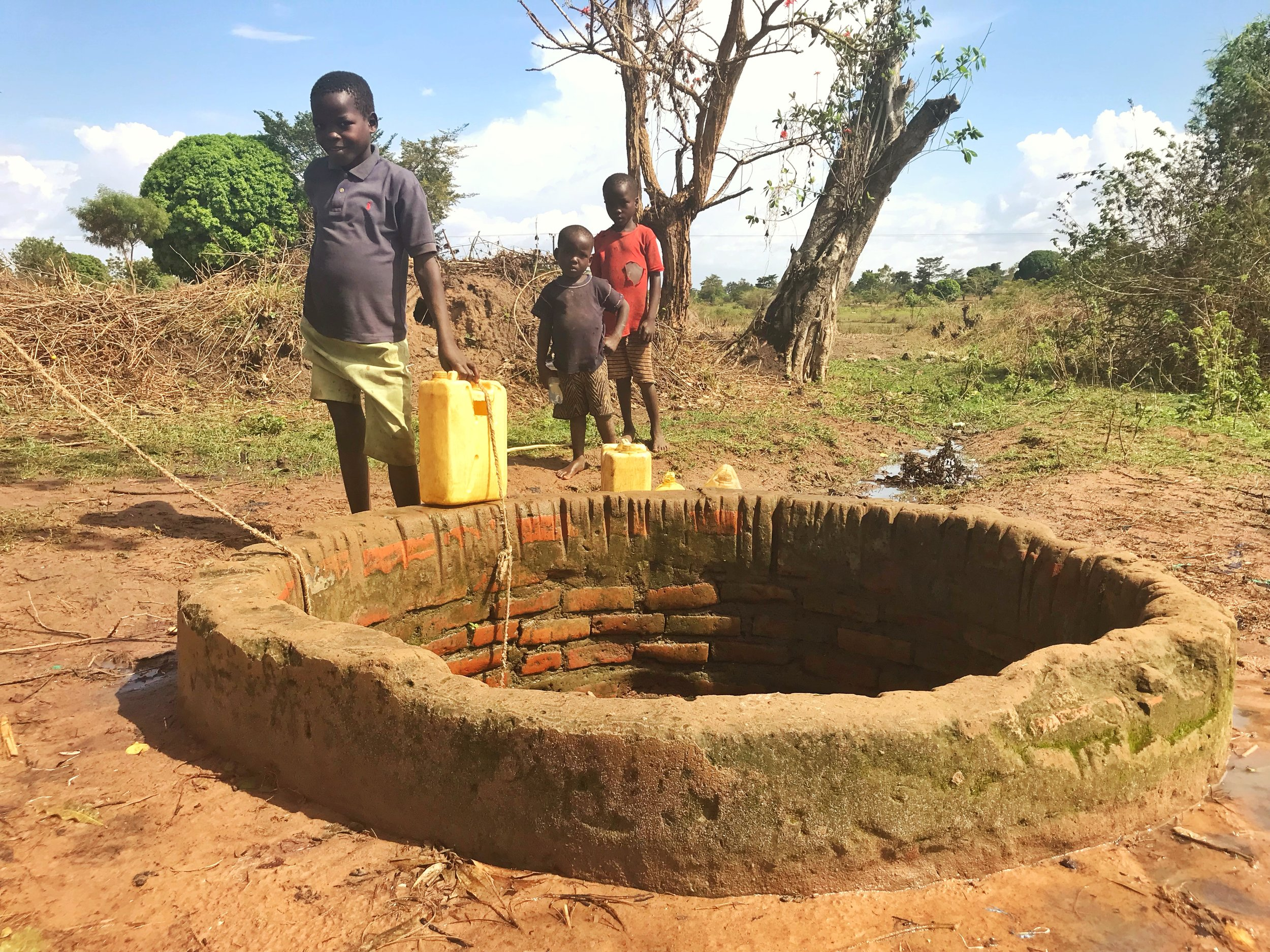 Surface water is retrieved from this old hand dug well in this 1,000+ member community.  many reports of waterborne disease were shared with our team during a visit to this area of uganda.  how would you solve this problem?