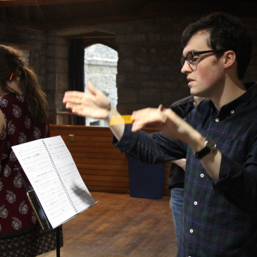 Conducting rehearsals for 'Autopilot Saves Model S', a chamber opera in one act