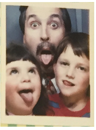 A photo of the author (right) in what might be his first photo booth shot ever.