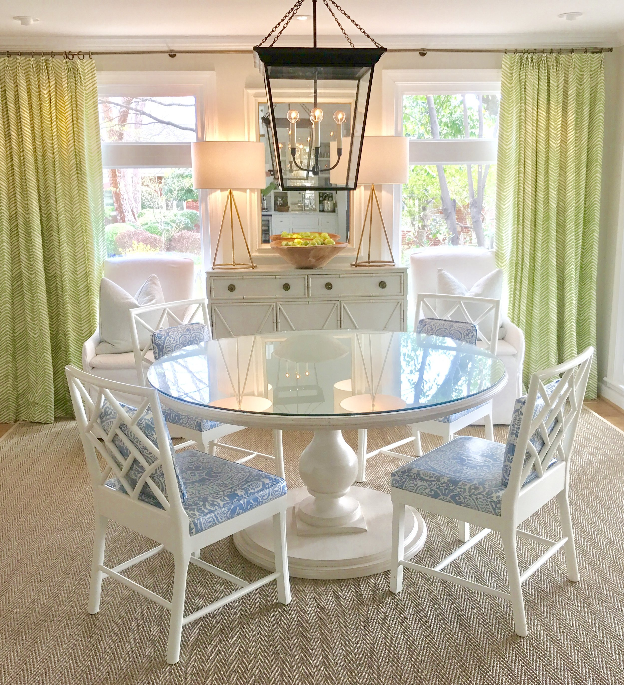 """Renowned Southern interior designer, Lucy Williams, is recognized for the bright, welcoming spaces she creates. For the dining room above, which is her own home, Williams says, """"We live on the water which inspired the color scheme for my house. Since we have a wall of windows, I wanted to bring the outdoors in. The Tritter Feefer pieces really capture the casual but elegant look that I was after.""""    Our classic Baluster dining table in St Moritz finish is the centerpiece of this space."""