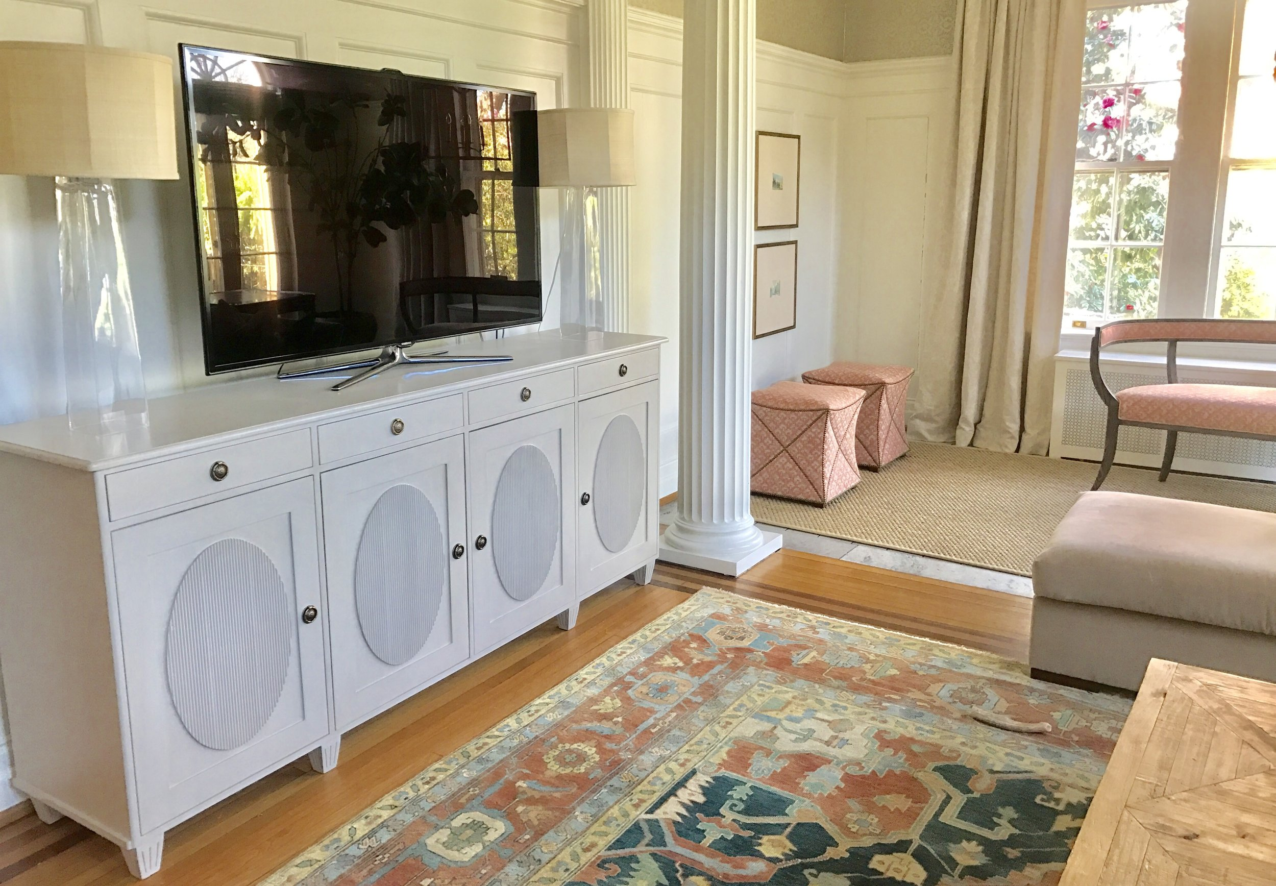 """For this client's home, which will be featured in the 2017 Virginia Garden Tour, Williams skillfully blended newer pieces with antiques and traditional architectural elements.  """"Because I use mostly new furnishings, Tritter Feefer's finishes and styles don't scream 'new' - very important to me.""""    On working with Tritter Feefer, Williams says, """"I love Tritter Feefer! It's an easy sell to my clients not only because of their updated traditional and transitional styles, but also Tritter Feefer caters to the perfect look for my coastal living aesthetic. Most importantly, Tritter Feefer's quality is top notch. You get what you pay for and I highly value knowing I am providing the best to my clients.""""    Williams chose our Helga buffet to step in as an elegant media console that also provides valuable storage in this family room."""