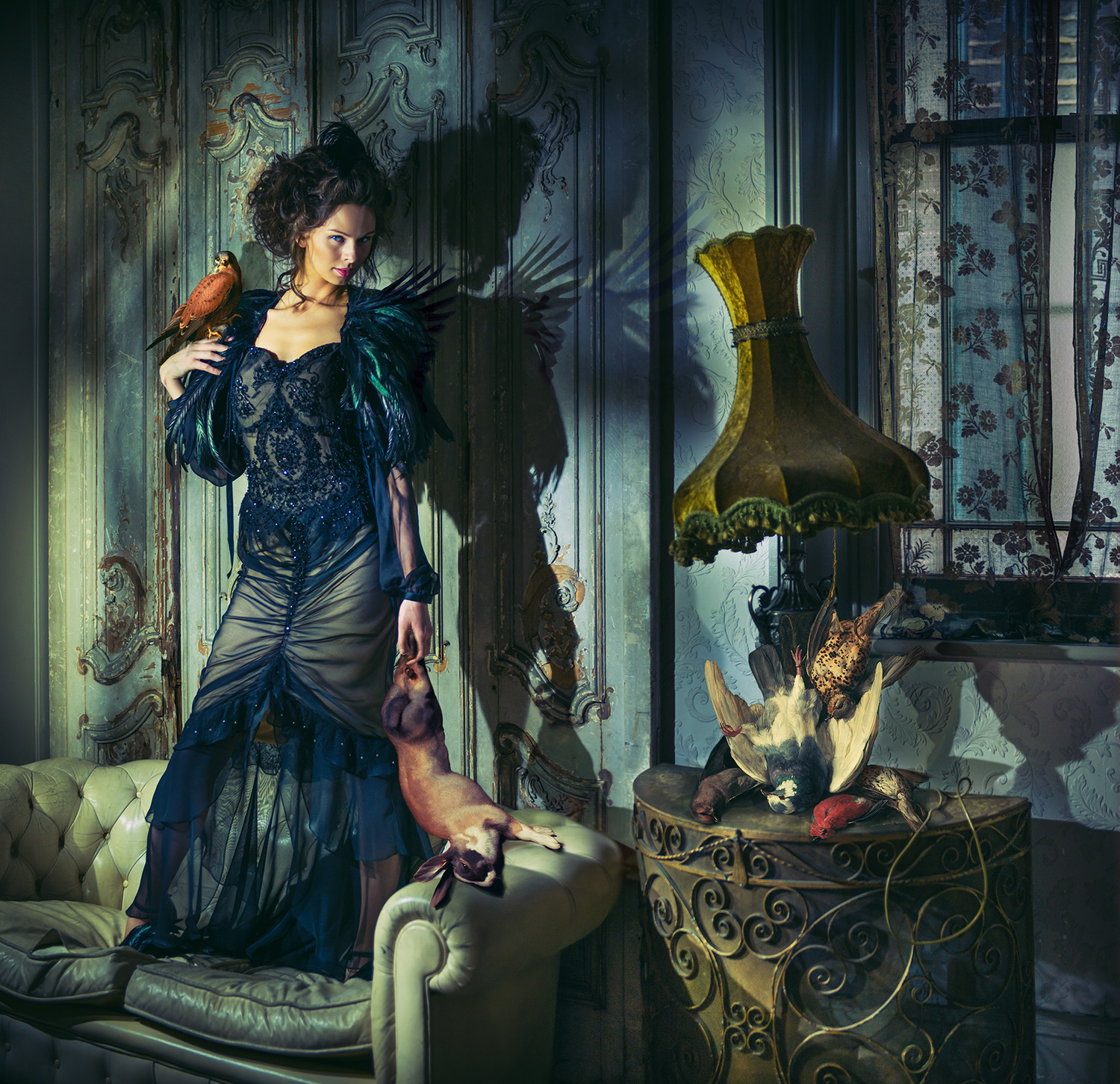 TRUSSED TROPHIES (2013) Rabbit from 'Still life with a dead rabbit and falcon'(1678) by Dirck de Bray. Birds under lamp from 'Still life of game', circa 19th cent by Andreas Lach. Model: Faye Shearwood / Stylist: Minna Attala / Dress: Busardi / Feather & cape: National Theatre Costume Archive / Hair: Doubravka Marcinkova / Make-up: Rhiannon Chalmers / Stylist's assistant: Becky Smith / My assistant: Tim Matthews. Shoot producer: Matt Lennard.