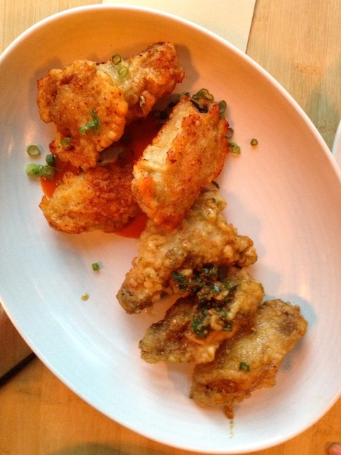 Twice Fried Chicken Wings:  													 smoked chili and kimchee ketchup on left;   salty carmel, serranos, and garlic on right.