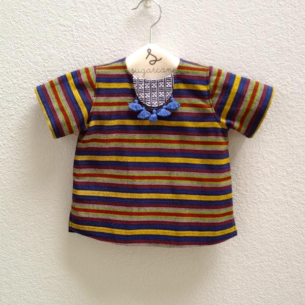 tunic with blue fringe