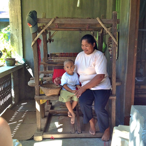 A loom at 1 of the mother's home so she can weave around her family's schedule. They are mothers first.