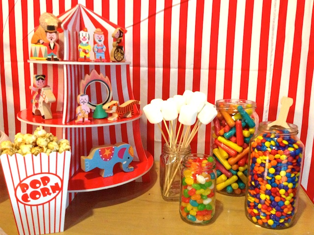 The Janod circus toys, dessert stand, popcorn boxes, and wooden candy scoops were flown in from California. Local candies and popcorn.