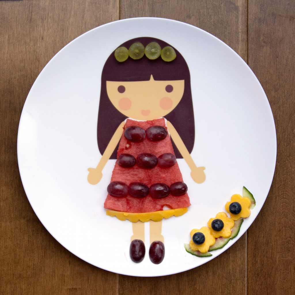 the first edible interpretation of a Sugarcane dress made with watermelon, grapes, and mango