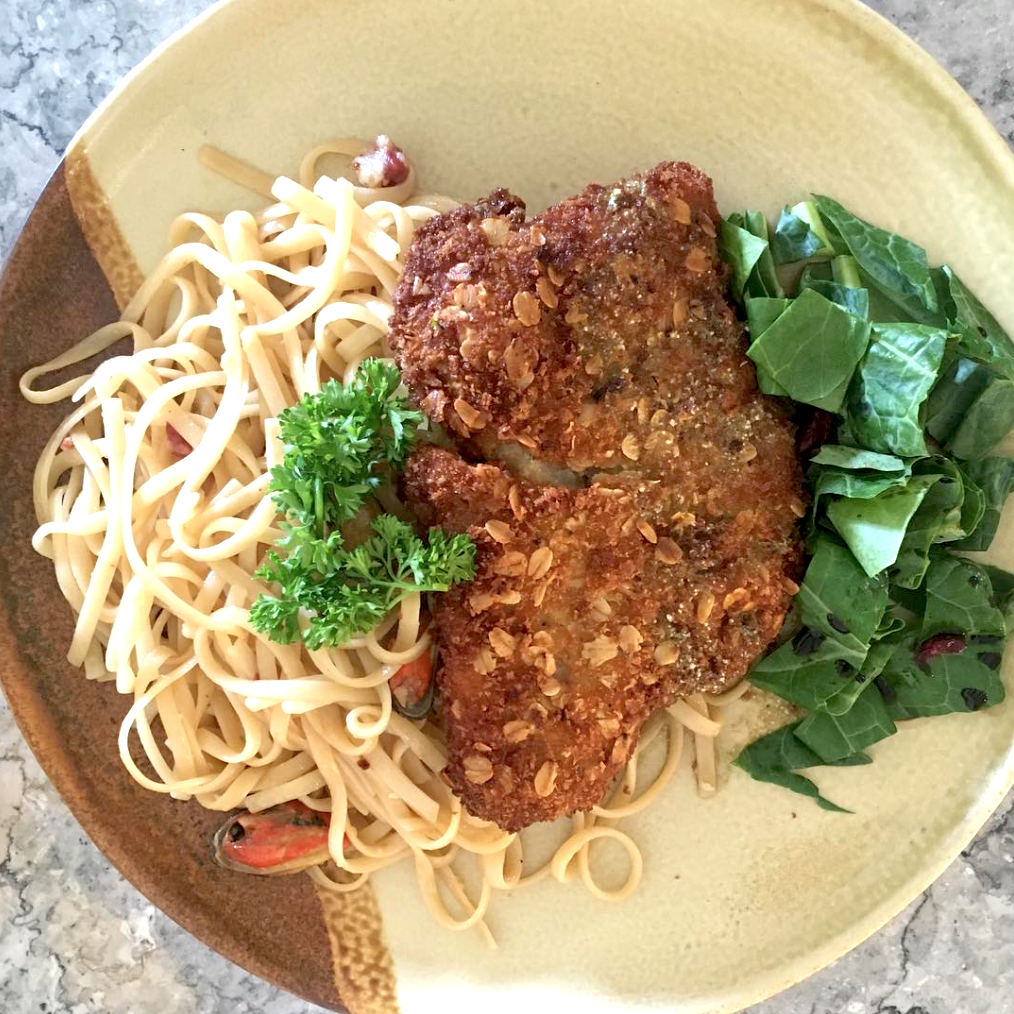 Oat & rye-crusted labahita on aglio olio seafood pasta