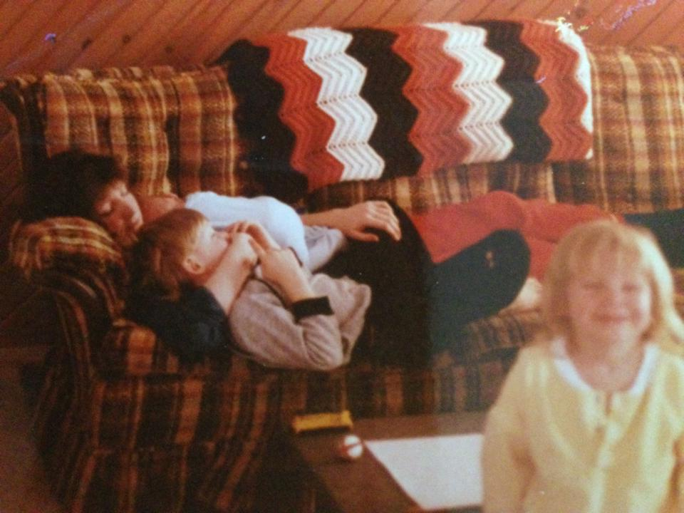 My mom cuddling with my brothers, and me cheesin' in the foreground. Typical. :)