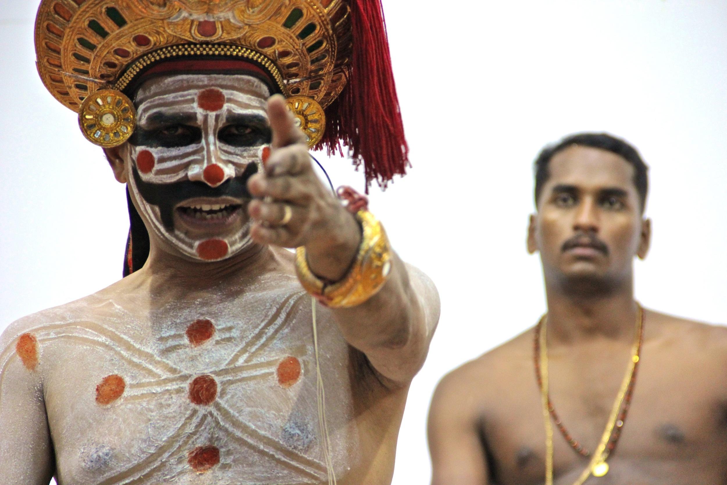 Painkulam Narayanan Chakiar and Jeyaraja (R) enacting the story of Princess Pancali in Calicut, India, Dec. 23, 2011.