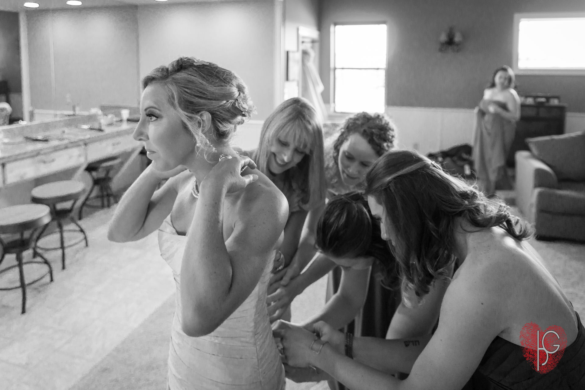 Bridesmaid helping the bride