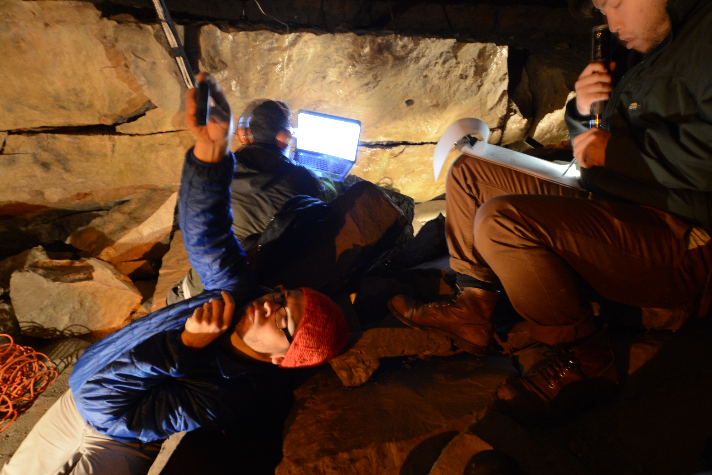 Here's a picture of us taking physical and sonic measurements in a fracture cave (Ryan Dewey, Ron Jost, Andrew Boji Wang, image taken by Jonathan Hooper). We were measuring the propagation of sound waves on the fossilized ancient seabed ripples where the dolomite layer meets the upper layer of limestone.